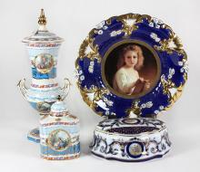 (Lot of 4) Continental style porcelain table articles, including a Limoges style tea caddy and a lidded urn, each having Sevres blue...