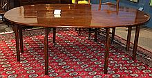 George III drop leaf harvest or wake table, circa 1790, executed in Cuban or Santo Domingo mahogany, having an oval top with lateral...