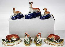 (lot of 7) Diminutive Staffordshire figural groups depicting Whippets, comprising a pair of sleeping Whippets on oval bases, 1