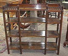 Regency rosewood etagere, 19th century, having a pierced gallery in the Gothic taste, above three lower tiers, and having octagonal ...