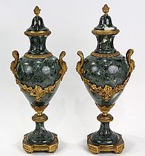 Pair of French Neoclassical style gilt bronze mounted urns