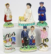 (lot of 6) Staffordshire porcelain figural groups of children, comprising, a quill holder depicting a boy crying over a rabbit hole,...