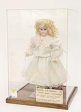 Antique German bisque doll in case