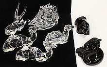 (lot of 7) Baccarat and Waterford crystal animals, consisting (2) Baccarat clear crystal reclining camels, (1) Baccarat clear crysta...