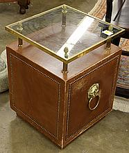 (Lot of 2) Continental style side cabinet, having a glass top surmounting the leather wrapped case accented with brass nail head tri...