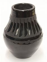 Maria and Santana style San Ildefonso pottery vase, of elongated form, executed in black on black with feather design at the shoulde...