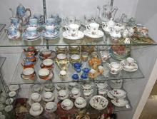 Three shelves of children's and doll house china