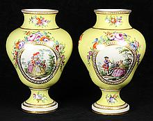 Pair of German porcelain urns decorated by the workshop of Helene Wolfsohn, circa 1860, in the Rococo taste, centering a scenic rese...
