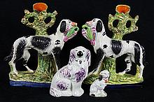 (lot of 4) Associated Staffordshire dog group, consisting of a miniature seated spaniel, 3