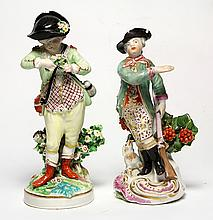 (lot of 2) Derby porcelain figures, circa 1760, consisting of a hunter having a rifle at his side and resting on a Rococo base, 6