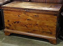 Continental Primitive cedar lined blanket chest, circa 1900, having a hinged top surmounting the rectangular handled case with expos...