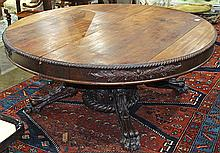 American Empire style mahogany center table, reduced, late 19th century, the circular top having a gadrooned border, above a tripod ...