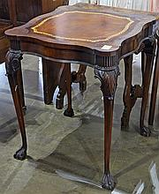 Victorian mahogany side table having an embossed leather top, and rising on claw and ball feet, 27