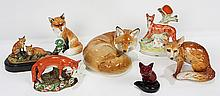 (lot of 7) One shelf of porcelain and pottery fox figurines, including a seated fox by Royal Worcester, 7