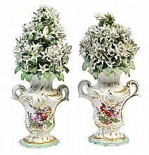 Pair of Derby porcelain vases, circa 1770, each decorated with applied white lilies, above the Classical style urn form base decorat...