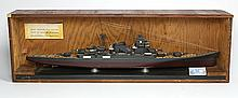 WWII era model of a Japanese Battle Cruiser, circa 1941, the carved wooden model resting in a custom case with a Japanese metal tag ...