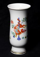 Meissen porcelain vase in the Chinese taste, of beaker form, having a gilt band and the rim and foot and decorated with a crouching ...