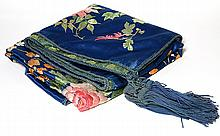 Embroidered silk piano shawl, having a polychrome floral medallion with tendrils on a sapphire blue ground, backed in brocade and ha...