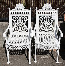 (lot of 2) Gothic Revival white painted cast iron garden armchairs, 19th century, having arched crests with medallions above entabla...
