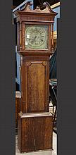 George III tall case clock, executed in oak, having a broken pediment top, above a single door opening to a brass Roman numeral dial...