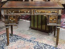 Neoclassical ebony ladies writing desk, 19th century, the rectangular top having an embossed leather writing surface, above the four...