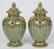 Pair of KPM jeweled porcelain lidded urns
