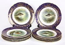 (lot of 12) Signed English cabinet plates having a hand painted marine scenes of game fish, including Sear Bass, Grayling, Salmon, a...