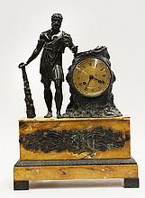 Classical style patinated bronze mantle clock, depicting a Roman figure dressed in period attire, with arm resting on a naturalistic...
