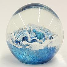 Studio glass paper weight, executed in iridescent blue and white glass cased in clear, depicting a snow capped mountain range, signe...