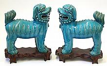 Two Chinese Turquoise Porcelain Lions