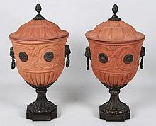 PAIR OF BRONZE MOUNTED TERRACOTTA CAPPED URNS