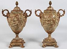 PAIR OF DECORATIVE PAINTED URNS WITH EMBOSSED CUPID DESIGN