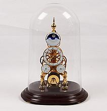 GLASS DOMED SINGLE FUSEE DORE METAL SKELETON CLOCK