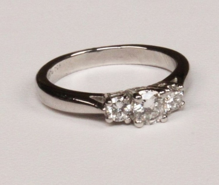 PLATINUM TRIPLE STONE DIAMOND RING