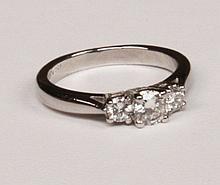 PLATINUM TRIPLE STONE DIAMOND RING