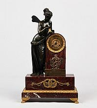 FRENCH ROUGE MARBLE AND DORE BRONZE MOUNTED FIGURAL CLOCK