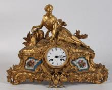 FRENCH GILT BRONZE AND SEVRES PLAQUE MOUNTED CLOCK