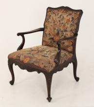 GEORGE III STYLE CARVED MAHOGANY GAINSBORO ARM CHAIR