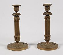 PAIR OF LATE FRENCH REGENCY BRONZE COLUMN FORMED CANDLESTICKS