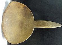 7. Primitive Wooden Ladle