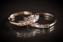 2 Diamond Wedding Bands, one platinum