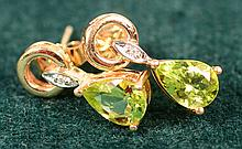 4.0 tcw peridot earrings w/dia accents 14kt
