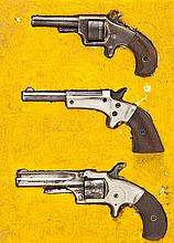 3 Spur Trigger Handguns in Display Case