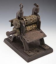 Antique Cast Iron Candy Roller