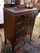 Twentieth century oak display cabinet, pair glazed