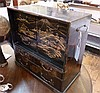 Oriental black lacquered table cabinet, with gilt