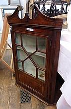 Georgian mahogany hanging corner cupboard, having