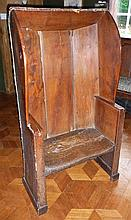 Eighteenth century elm settle chair with panelled
