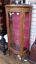 Early 20th century mahogany serpentine vitrine,