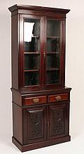 A Victorian walnut two section bookcase